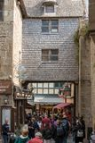 A crowd of tourists on Grand Rue, the main street in Mont Saint Michele. Normandy, France. Le Mont-Saint-Michel, France - September 13, 2018: A crowd of tourists stock photography