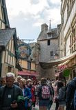 A crowd of tourists on Grand Rue, the main street in Mont Saint Michele. Normandy, France. Le Mont-Saint-Michel, France - September 13, 2018: A crowd of tourists stock images