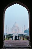 Crowd of tourists at Main Gate to Taj Mahal in the fog early morning Royalty Free Stock Photos