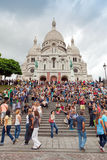 Crowd of tourists near Sacre Coeur Basilica in Paris Stock Image