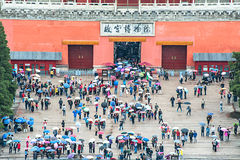 Crowd tourists out from Forbidden City. Beijing, China - May 11, 2014: Crowd tourists out from Forbidden City, The Chinese charactors in the building is : The Stock Photography