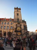 The crowd of tourists photographed clock in the square Stare Mes Stock Images