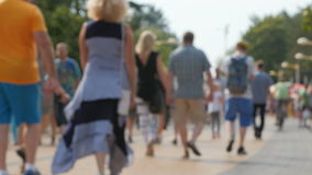Crowd of tourists in the resort city. Crowds of tourists in the resort town. Palanga, Lithuania, the image blurred, no recognizable people stock video