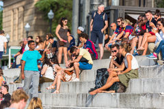Crowd of tourists sit on the National Palace stairs in Barcelona Royalty Free Stock Photography