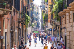 CROWD OF TOURISTS ON A STREET OF VERONA Stock Photography