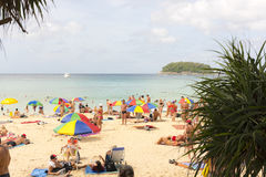 Crowd tourists, sunbed and umbrellas  on the beach Royalty Free Stock Images