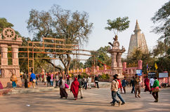 Crowd of tourists walk past holy buddhist Temple Stock Images