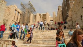 Crowd of travellers viewing ruins of Parthenon temple, place of tourist interest. Stock footage stock video