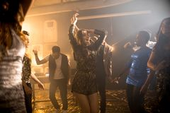 Young Woman Dancing in Club royalty free stock photos