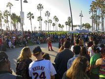 Crowd in Venice Beach, California. Crowd gathered in a park in tropical Venice, California Stock Images