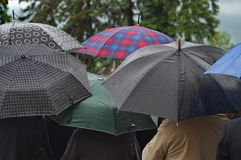 Crowd with umbrellas in the rain Royalty Free Stock Images