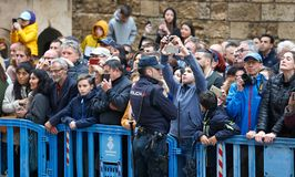 Public waiting to picture and see the royal spain family attending to an easter mass royalty free stock photos