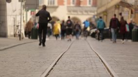 Crowd of unrecognizable people walking on the street. Crowd of unrecognizable people walking toward city centre stock footage