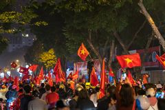 Crowd of Vietnamese football fans down the street to celebrate the win after soccer, with a lot of Vietnamese flags raising high Royalty Free Stock Photography