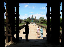 Crowd of visitors at Angor Wat temple complex Stock Photo
