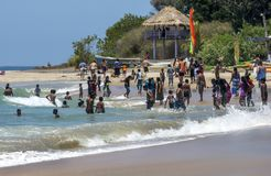 A crowd of visitors to Arugam Bay. royalty free stock photography