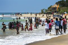 A crowd of visitors to Arugam Bay. royalty free stock photo