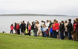 Crowd waiting for Olympic Flame to arrive. John O'Groats, Caithness, Highlands, Scotland, United Kingdom - June 10, 2012: Crowd waits for Olympic Flame to arrive Stock Photography