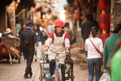Crowd walking in Shuhe ancient town. Stock Image
