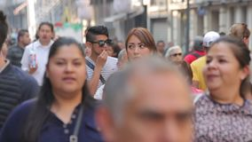 Crowd walking through street. Mexico City, Mexico-CIRCA June,2017 TAKE 4: Crowd walking through street stock video footage