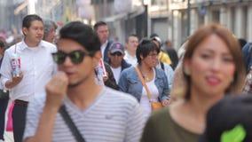 Crowd walking through street. Mexico City, Mexico-CIRCA June,2017 TAKE 3: Crowd walking through street stock footage