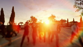 Crowd walking at sunset stock footage