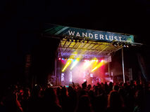 Crowd watches Griz performs on stage during night concert Stock Images