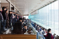 Crowd watches the horse race Royalty Free Stock Photo