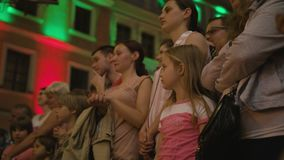 Crowd Watches Sword Swallower Show in Lublin. Lublin, Poland - July 2017: Little girl watches Krystian Minda`s Sword Swallower Show in Lublin at night, during Royalty Free Stock Photo