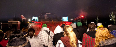 Crowd watches urban snowboard contest. Stock Photos