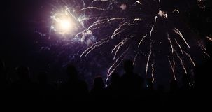 Crowd watching fireworks and celebrating new year eve royalty free stock photography