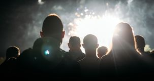 Crowd watching fireworks and celebrating new year eve royalty free stock image