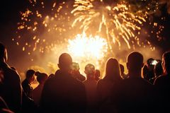 Crowd watching fireworks. And celebrating at night Royalty Free Stock Photo