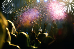 Crowd watching fireworks at New Year Stock Image