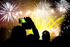 Crowd watching fireworks at New Year Royalty Free Stock Photo