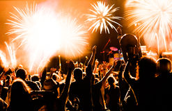Crowd watching fireworks at New Year Stock Photography