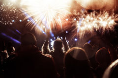 Crowd watching fireworks at New Year Stock Photos