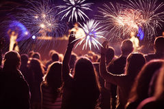 Crowd watching fireworks at New Year Stock Images
