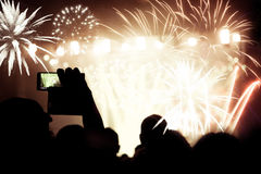 Crowd watching fireworks at New Year Royalty Free Stock Photos