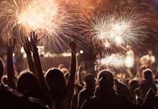 Crowd watching fireworks at New Year Royalty Free Stock Images