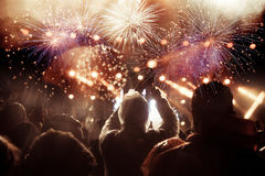 Crowd watching fireworks at New Year Royalty Free Stock Image