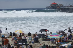 Crowd watching high surf stock images