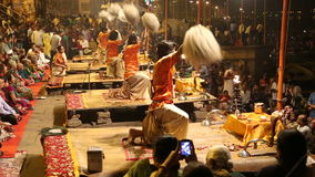 Crowd watching hindu priests performing at Ganga Aarti ritual in Varanasi. VARANASI, INDIA - 20 FEBRUARY 2015: Crowd watching hindu priests performing at Ganga stock video