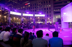 Crowd watching a performance at cyberhub gurgaon. Gurgaon, India; 5th Nov 2014: Crowd watching a live performance at the amphitheater at cyberhub gurgaon Royalty Free Stock Photography