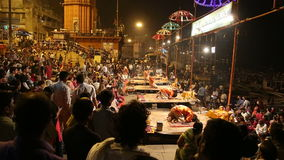 Crowd watching performance with fire at Ganga Aarti ritual in Varanasi. VARANASI, INDIA - 20 FEBRUARY 2015: Crowd watching performance with fire at Ganga Aarti stock video footage