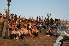 Crowd watching the setting sun. Stock Photos