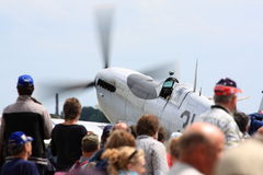 Crowd watching Spitfire at airshow Stock Photography