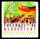 Crowd waving Flag, German Football Enthusiasm serie, circa 2012. MOSCOW, RUSSIA - FEBRUARY 21, 2019: A stamp printed in Germany, Federal Republic shows Crowd royalty free stock images