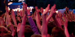 The crowd who raised their hands at the concert stock photography