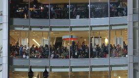 Crowd at windows stock footage